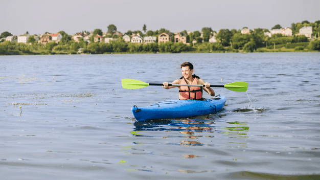 single man using coleman inflatable kayak